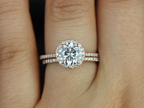 Simple, airy, and timeless. This ring will not only stop traffic from the sparkles but it will also be SUPER GORGEOUS for decades due to the