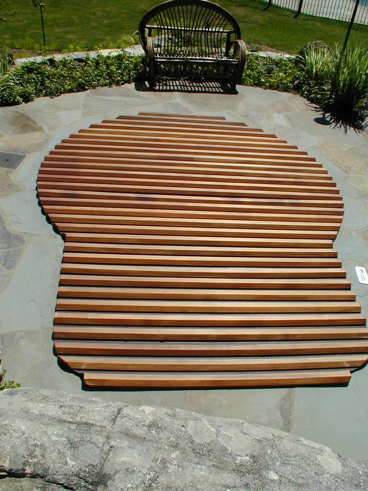 Custom built Great Northern Roll-Up® Cover for in-ground hot tub.