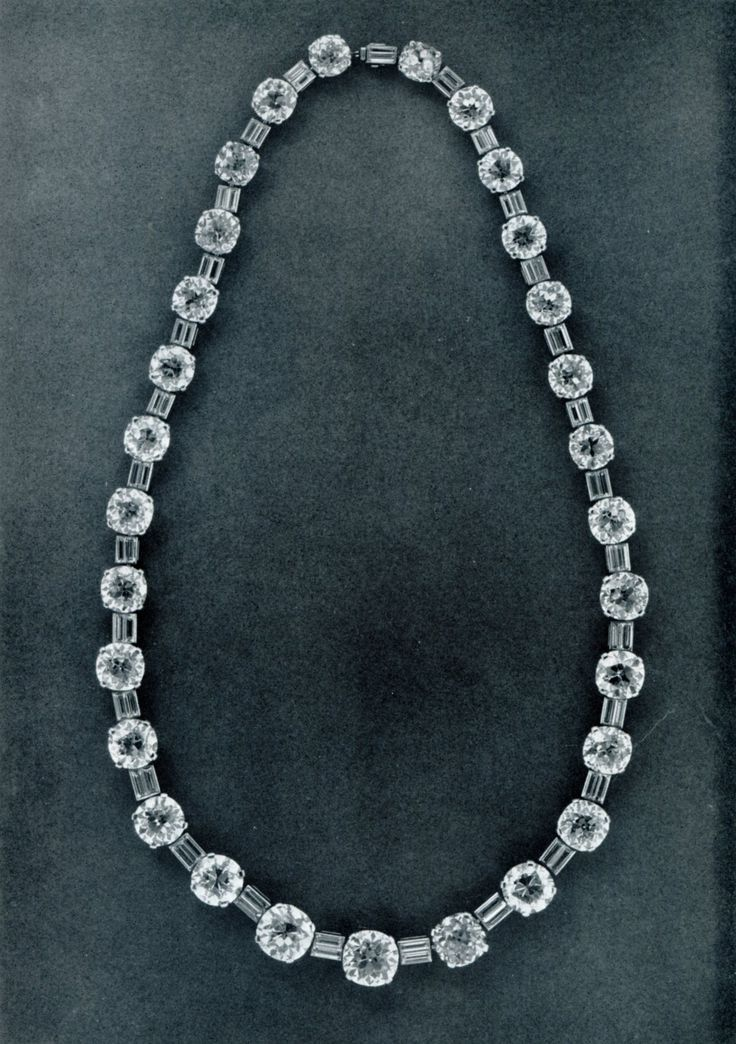 This necklace was sold in 195 for US$105,000 by Sothebys.  The round diamonds are from a riviere given to Princess Irina of Russia by her un...