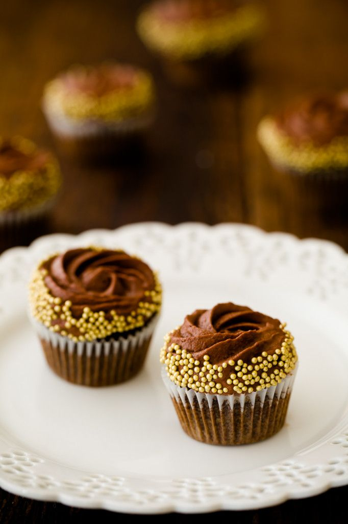 Chocolate rum cupcakes with chocolate mousse frosting.  Sometimes cupcake recipes can go frosting-free, the cake a perfect dessert all on its own.  These chocolate rum cupcakes, however, should always be presente...