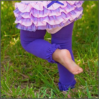 Ruffled Purple Tights. These gorgeous tights are made of a stretchy knit legging fabric to give them a super soft feel and nice warm texture. Accented with a soft ruffle along the bottom edge, they are unique and absolutely adorable!