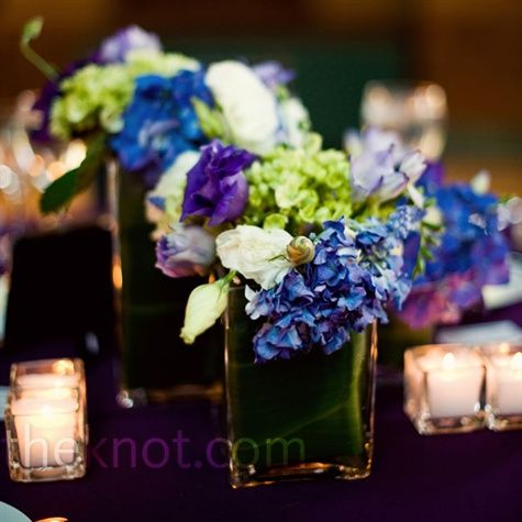 Green and Blue Centerpieces    Hydrangeas and other in-season flowers in vases of varying heights decorated the reception tables.