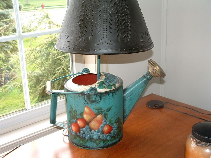 Painted old watering can (made into a light). This was ...