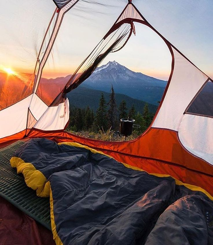 I love the framing that is used in this picture because it shows the inside of the tent as well as the beautiful scenic view. This creates a very touristy and outdoorsy mood.