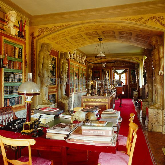 Jacques Garcia ~ his library - The vaulted ceiling of the impressive library is supported by Egyptian caryatids