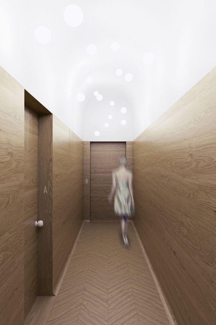 PERŁA BREWERY APARTMENTS | minimal hotel corridor design, oak, wood wall panels, chevron wood floor, hotel door design