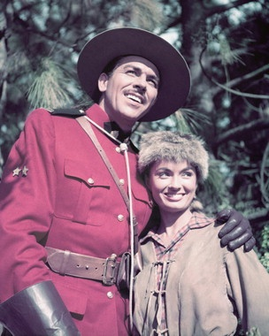 A Mountie and a woman in buck skin. Its a Saturday thing. Howard Kee l Ann Blyth Rose Marie