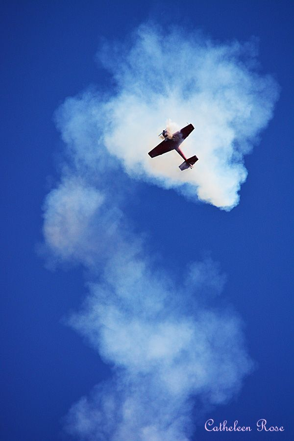 A cool picture of an airplane during an airshow at the Arlington Fly In.