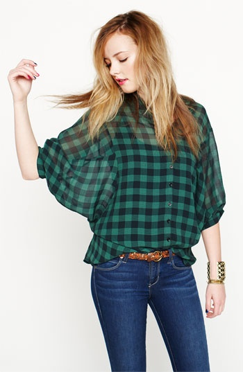 Fire Buffalo Check Shirt (Juniors) Buffalo checks punctuate a gauzy button-front shirt with generous dolman sleeves and a trend-perfecting silhouette that can be adjusted from fuller to more fitted buttons at the back