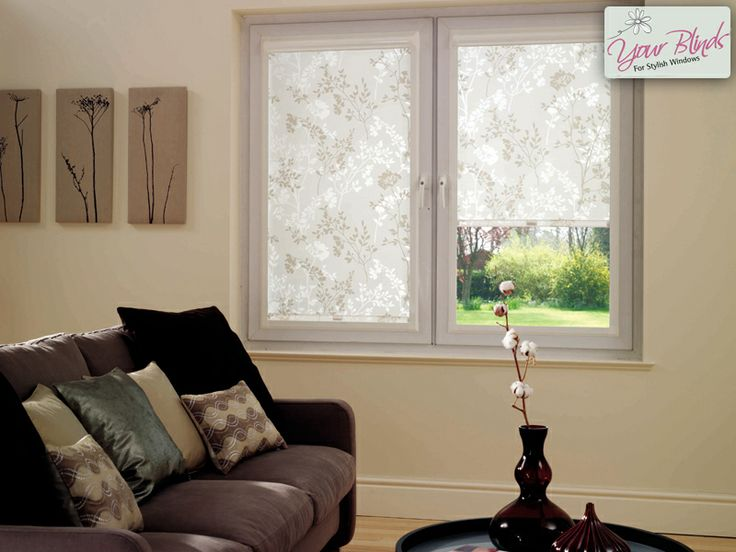 Pretty, semi-transluscent blossom roller blinds in Perfect Fit frames.
