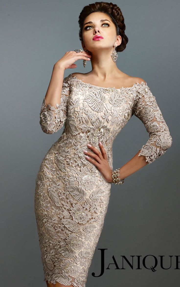Achieve the next level of sophistication in Janique 548. This glamorous cocktail dress features an off shoulder neckline with three quarter length sleeves. Flower and vine embroidered applique wraps the top over clear lining. The short sheath skirt is trimmed at knee length hem that enhances your hourglass shape.