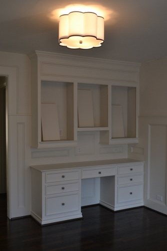 built-in desk/hutch. Put canvases in the spaces and light them instead of adding shelves or doors. Also love the molding.