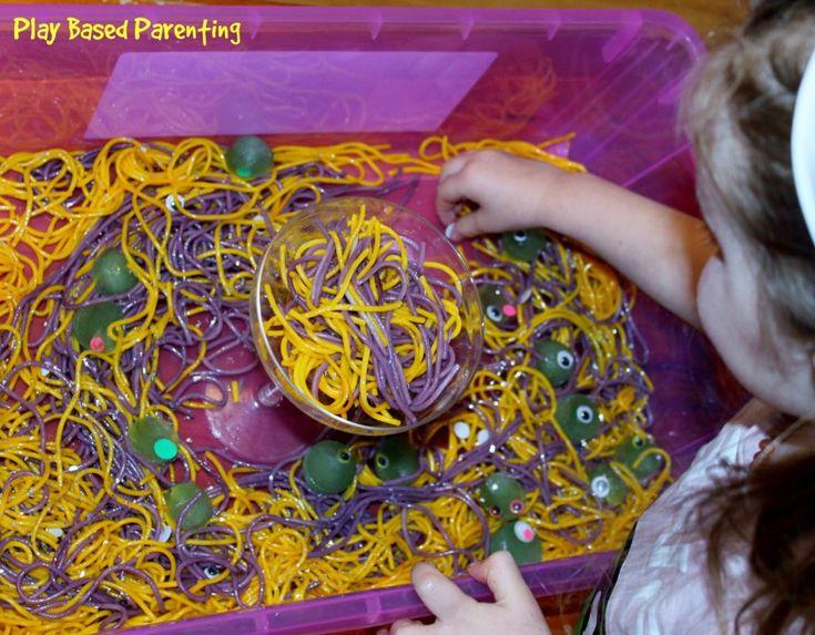 Sensory Spaghetti play tub for Halloween.  Monster eyes, Ice Eye-balls and slime.  http://play-based-parenting.com/sensory-spaghetti-play-tub/