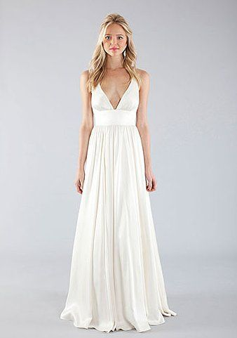 20 of the Best Beach Wedding Dresses For Any Bride-to-Be: We love the simplicity and understated femininity of this Nicole Miller gown ($1,455).