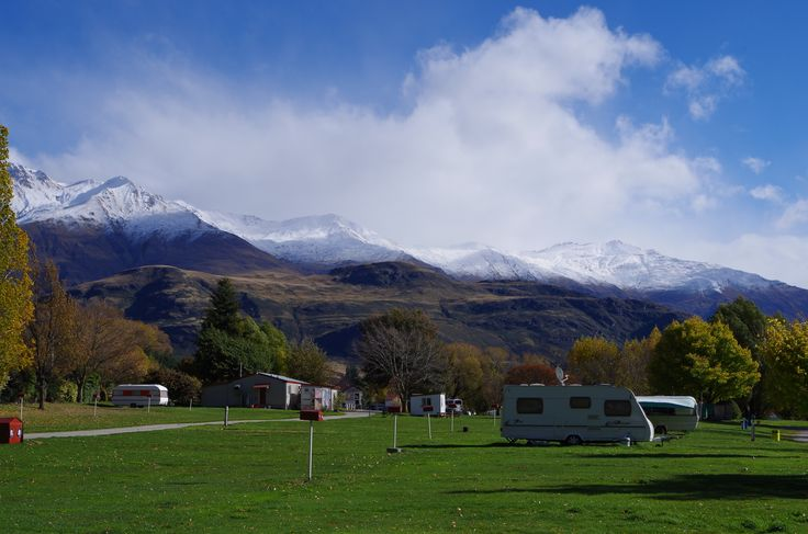 Snow falling onTreble Cone Mountain , viewed from Glendhu Bay, on the shores of Lake Wanaka, South Island, New Zealand.