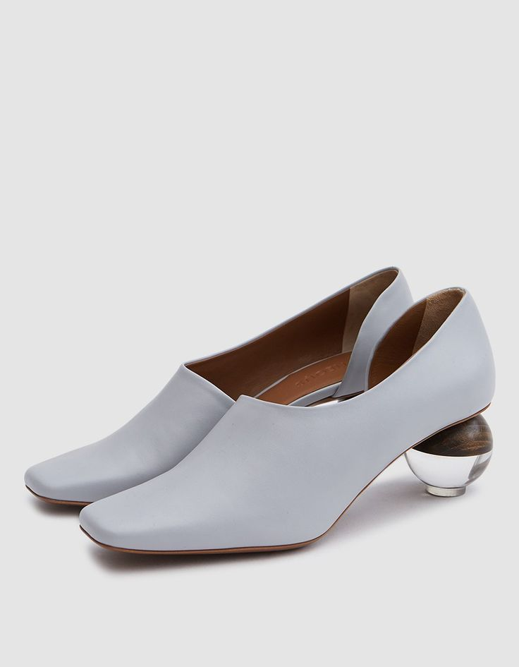 "Square toe pump from Neous in Grey. Slips on. Calf leather upper. Tonal stitching. Padded footbed with embossed logo. Leather lining. Transparent and carved wood sphere heel. • Leather upper • Leather sole • 2.25"" heel • Made in Italy"