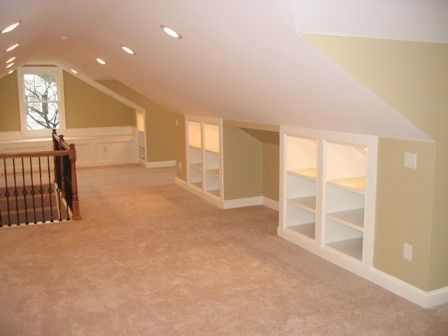 Finished attic with built in storage. Would work well with drawers too...built in dresser to not take up limited space in an attic bedroom.