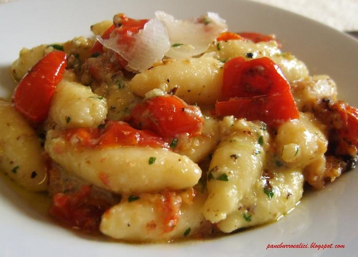 Gnocchi di ricotta con pomodorini al forno e pesto di noci, prezzemolo e caprino stagionato....I don't know what this says, but it looks amazing...