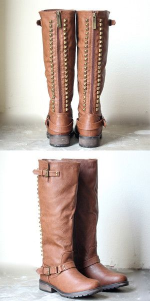 Amazing tones of dark chestnut brown adorn these tall riding boots. Features a brassy studded back, exposed contrasting back zipper, side zipper, and buckles de