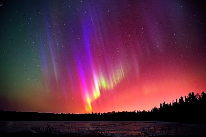 Bright northern lights in Thunder Bay by Justin T. Stevens