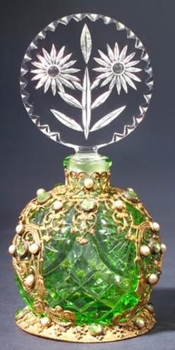 A Czechoslovakian perfume bottle, circa 1920s, in green and clear crystal, with jeweled metalwork.