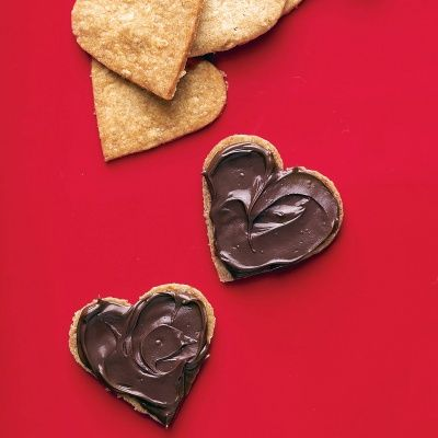 Heart Sandwich Cookies Recipe--These heart-shaped oat cookies are filled with a creamy chocolate-hazelnut filling.