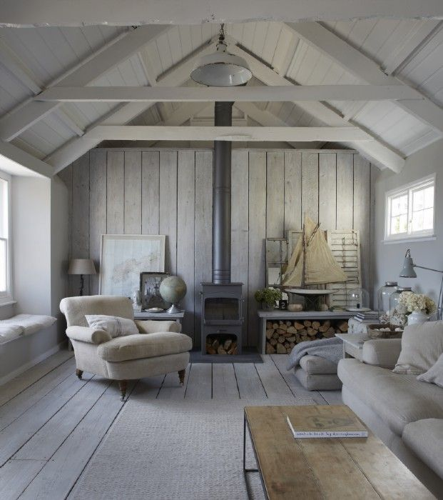 The wood panelled sitting room with logburner is spacious and filled with…