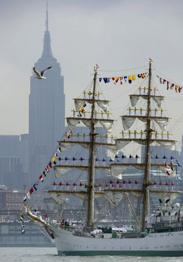 The tall ship from Colombia, Gloria, sails past the Empire State Building