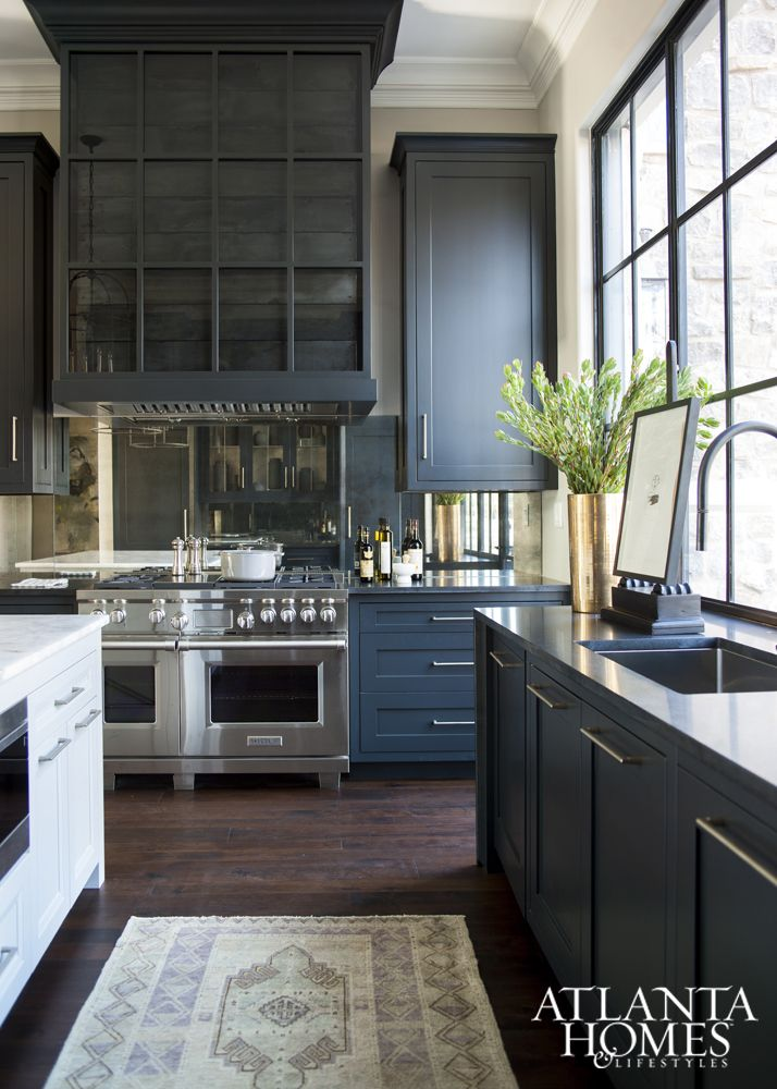 Black cabinets and a dramatic range hood
