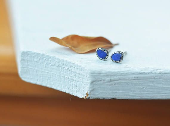 This is a sterling silver (hallmarked) and lapis lazuli earring made in my studio. The lapis are freeform, set into a unique little setting. Great colour for autumn, winter. The earring has patina for enhancement. It comes with plastic backs. I recommend it with this ring: https://www.etsy.com/listing/471764954/royal-lapis-lazuli-sacred-heart-custom?ga_search_query=lapis+lazuli&ref=shop_items_search_1  Size: 4 x 5 mm wide  Please check out my other items...