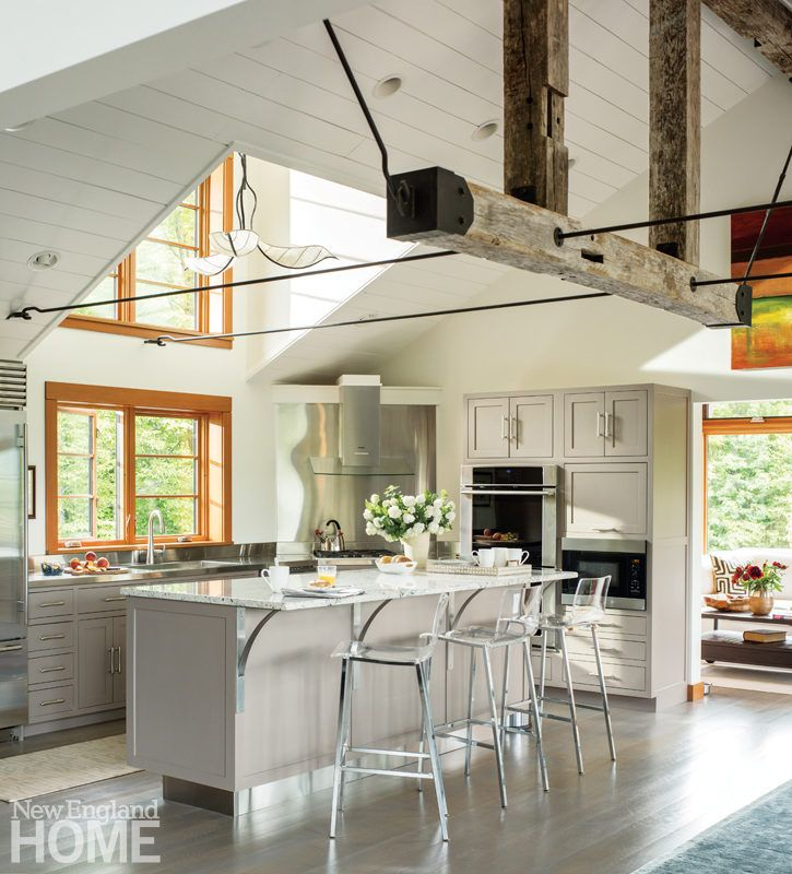 Reclaimed Vintage Barn Beams And Iron Tie Rods Anchor The Renovated Kitchen In A Home Designed