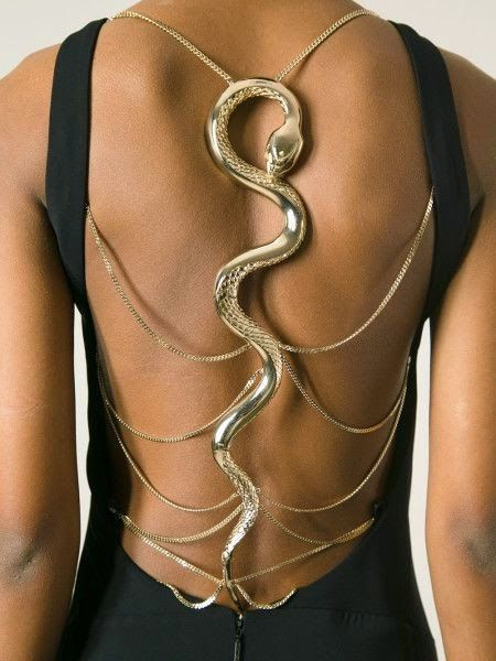 snake back detail at the back of a black evening dress