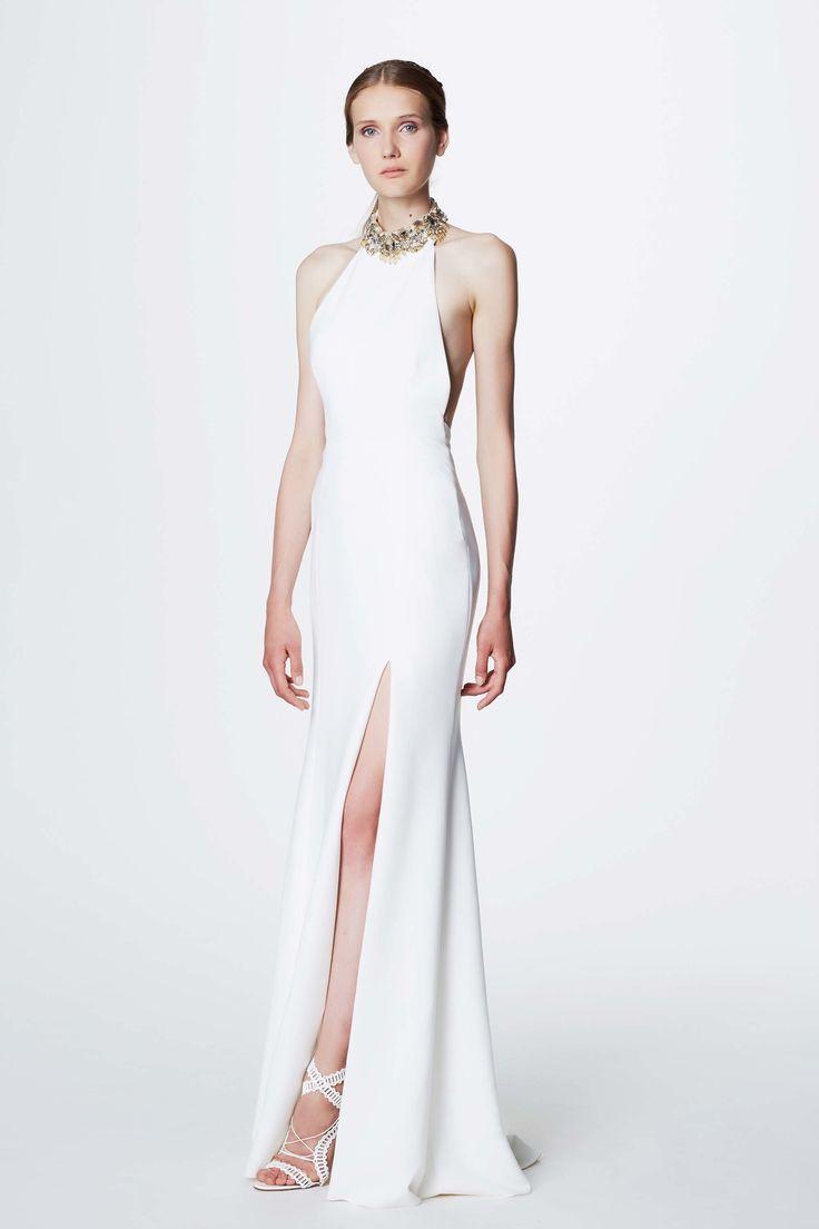 Marchesa Notte Resort 2017: Elegant white column halter dress with a slit and jeweled neckline.