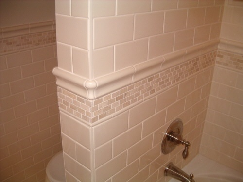 Close Up Of Tile Accent For Bathtub Surround Bathroom