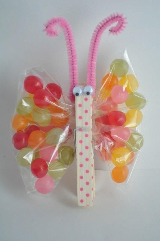 1) paint a clothespin, 2) attach googly eyes and antenna 3) fill plastic bag with candy 4) clip clothespin to the middle of bag to create the butterfly wings!