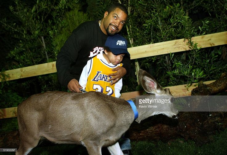 Actor Ice Cube and son pose with a deet at the after party of the premiere of 'Are We There Yet' at Barker Hanger on January 9, 2005 in Santa Monica, California.