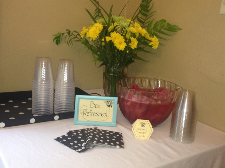 Punch table with Etsy printables and baby bee theme for shower.