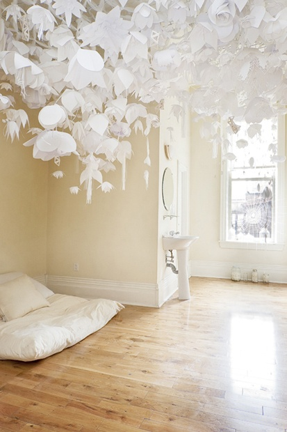 Room 211: Come Up To My Room 2010 by Krona & Lion  —  We created a cozy space complete with a dreamy canopy of paper flowers and porcelain ornaments above an oversized pillow bed, a swarm of chiming porcelain wings, a bead-crochet spiderweb and jars filled with various curiosities.  —  Photos by Agata Piskunowicz.