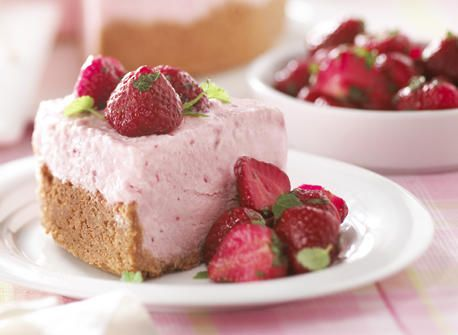 A delicious departure from the classic version, this cheesecake is served frozen, with a fresh strawberry and mint topping.