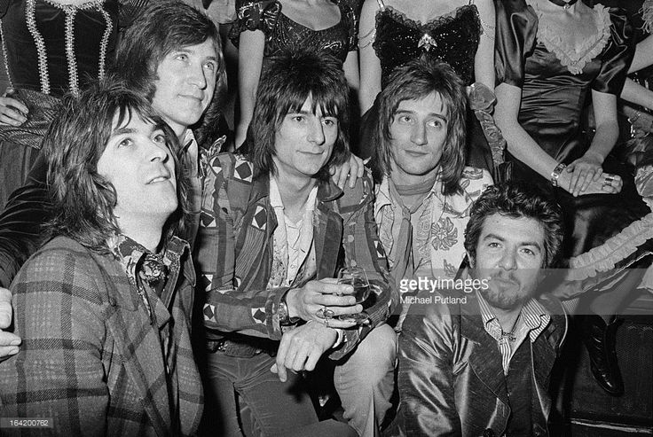 English rock group Faces at a reception at the Tramp nightclub in London for the release of their album 'Ooh La La', 5th April 1973. Left to right: keyboard player Ian McLagan, drummer Kenney Jones, guitarist Ronnie Wood, singer Rod Stewart and bassist Ronnie Lane (1946 - 1997).