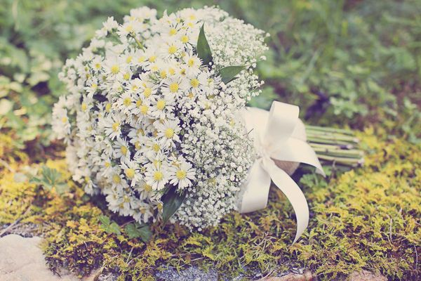 Cute, simple, natural bouquet made of daisies and baby's breath. Also, very affordable, which is always a plus!