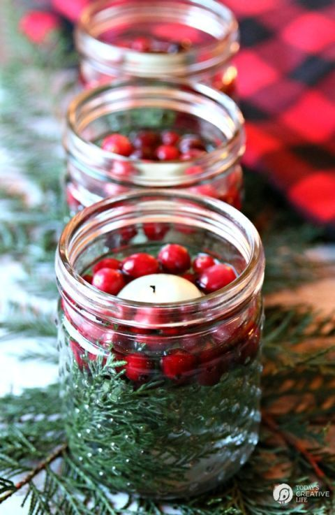 In just five minutes, you can create these stunning luminaries using jars (Mason jars are our pick, but pickle jars work just as well), cranberries, cedar clippings or something green, and floating candles.