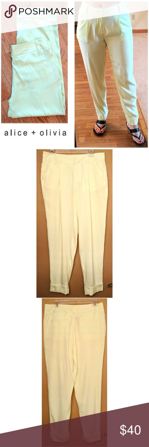 """🍋 NEW Alice + Olivia silk ankle lime  pants These awesome Alice + Olivia silk pants are perfect for dressing on any occasion! Lemon-lime soft silk tone with 5% spandex for stretch fit. Zipper and clasp closure, functional front pockets and slit back pockets. decorative folded up pant cuffs, pants are meant to be ankle fit since they are 28"""" but model is 5'2"""" petite. Size 6. Dress up or down with sandals and blouses, sneakers and tees... Possibilities are endless! NWOT UNUSED NO DAMAGES…"""