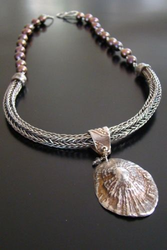 Jill Rockwell  |  Necklace: Sea Treasure from Cannes Handwoven Viking Knit in silver, Limpet molded from a real one collected off La Croissette in Cannes, France, and made of pure silver, oxidized. Freshwater pearls in a shimmery copper.