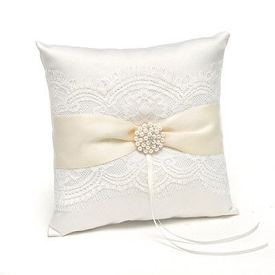 Accent your big day the elegant way with this gorgeous wedding ring pillow. It's all dressed up in an ivory satin sash, ivory lace and pearl accents. Dimensions 8x8