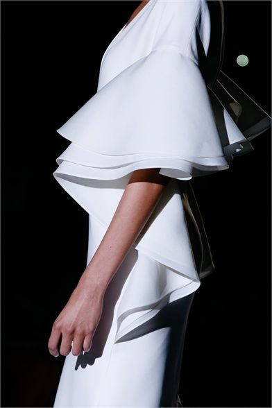 Long white dress with cascading ruffle sleeves; fashion details // Gucci SS13