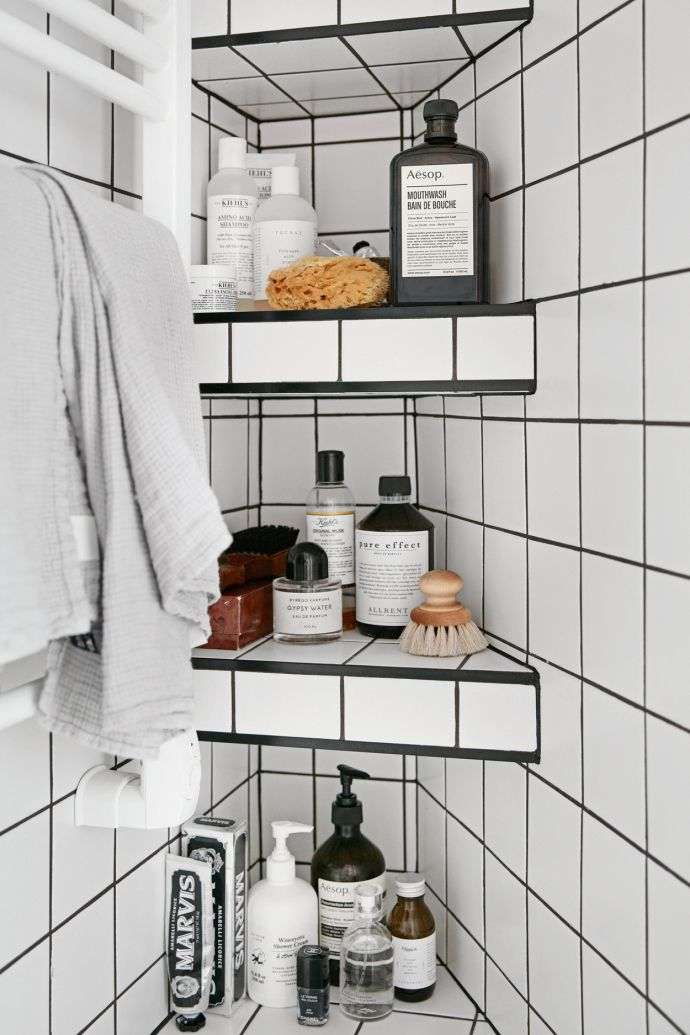 Tiled shower shelves to make clever use of an awkward little corner nook