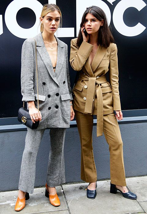 Giving major suitspiration, these girls prove that the new-season update is an oversized 80s silhouette: think double-breasted blazers with kick-flare crop trousers. Style with a striped shirt or logo tee and square-toe pumps in buttery-coloured leather. Finish with an all-business bag on chain and your office bestie