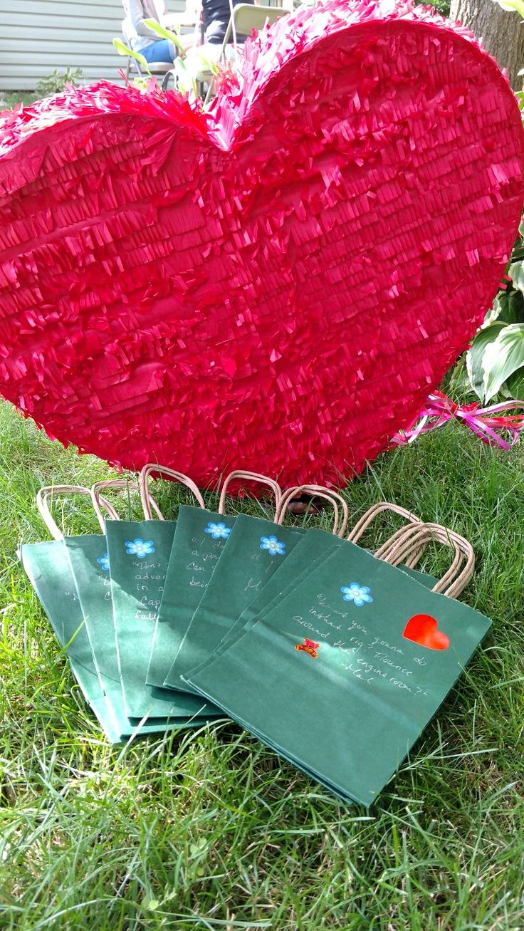 Heart pinata. Heather green bags with #firefly quotes and #Kaylee stickers