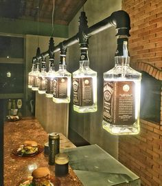 Whiskey bottle light fixture for kitchen #chandelier Dun4Me is the marketplace for custom made items built to your exact specifications by talented makers. Get bids for free, no obligation!(Diy Furniture)